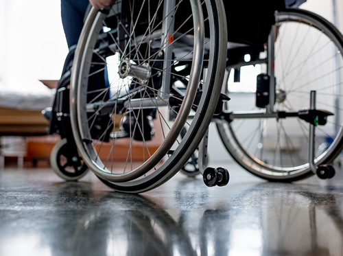 Rear, lower half view of patient in a wheelchair.