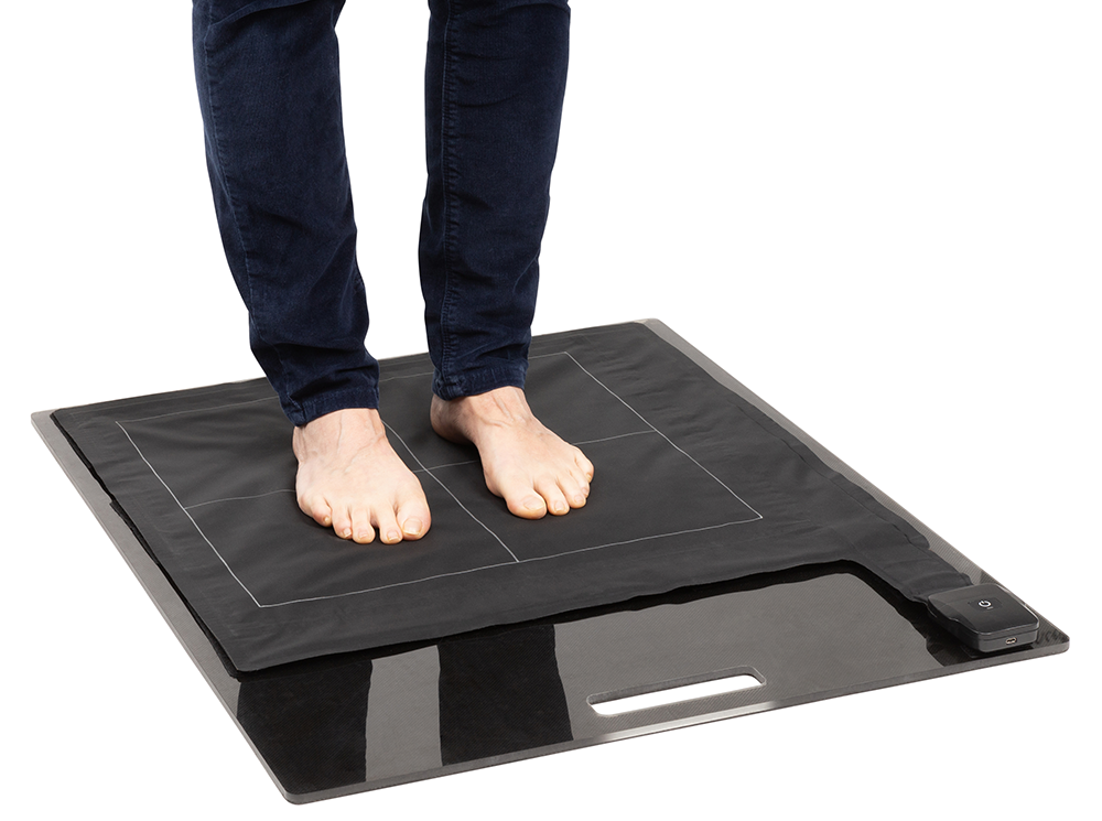 XSENSOR's Stance Pad Sensor capturing plantar pressure of a patient standing on the device.