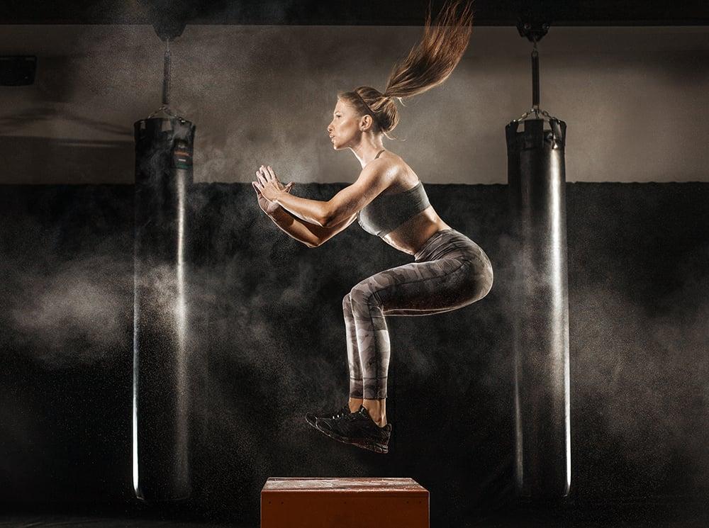 Athlete jumping onto a jump block.